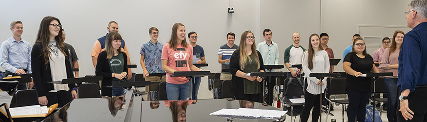 photo of students and a professor in a music class