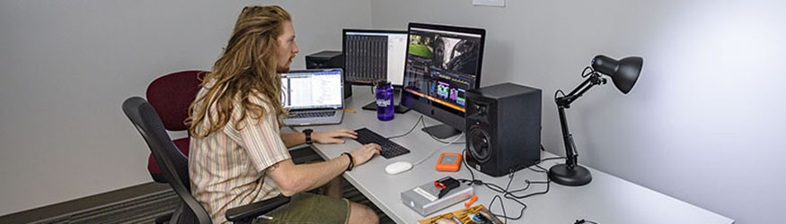 photo of student working at a computer