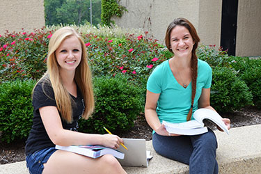 photo of two students studying outside