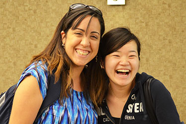 photo of two students laughing