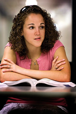 photo of a student with a textbook