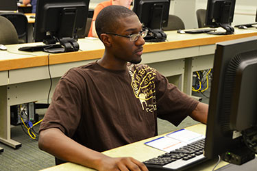 photo of a student in a computer lab