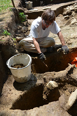 photo of a student at an archaeological dig