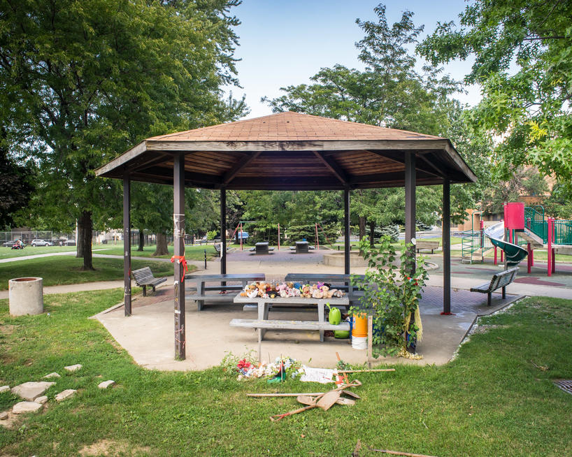 Artist photograph of park picnic shelter with stuffed animals laid as a memorial