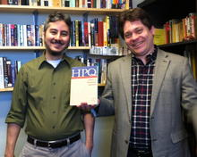 Dr. Donovan Miyasaki and Dr. Erik Banks display the issue of HPQ in which their articles appeared.