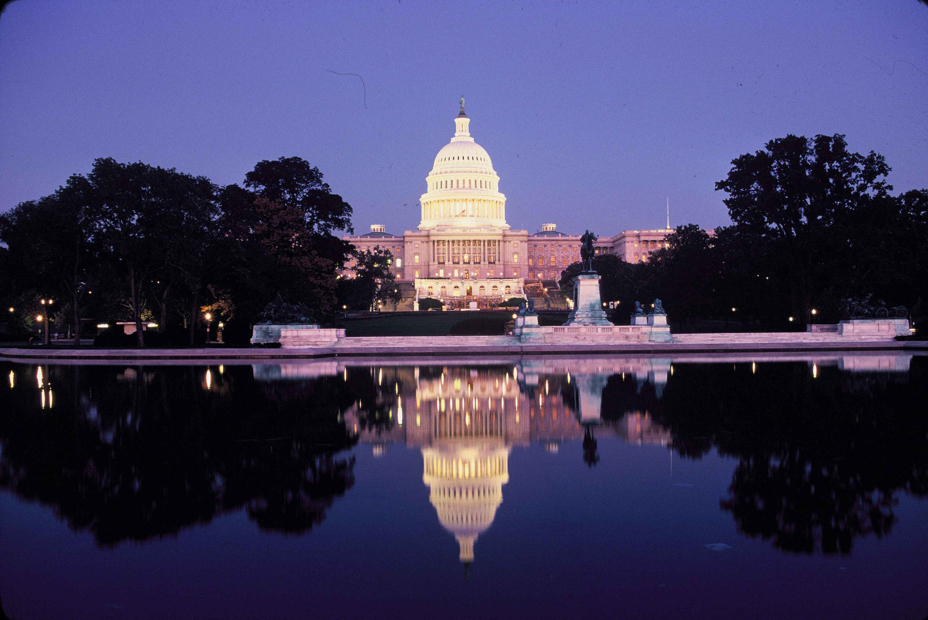 united-states-capitol-at-night-illuminated-with-decorative-lights.jpg